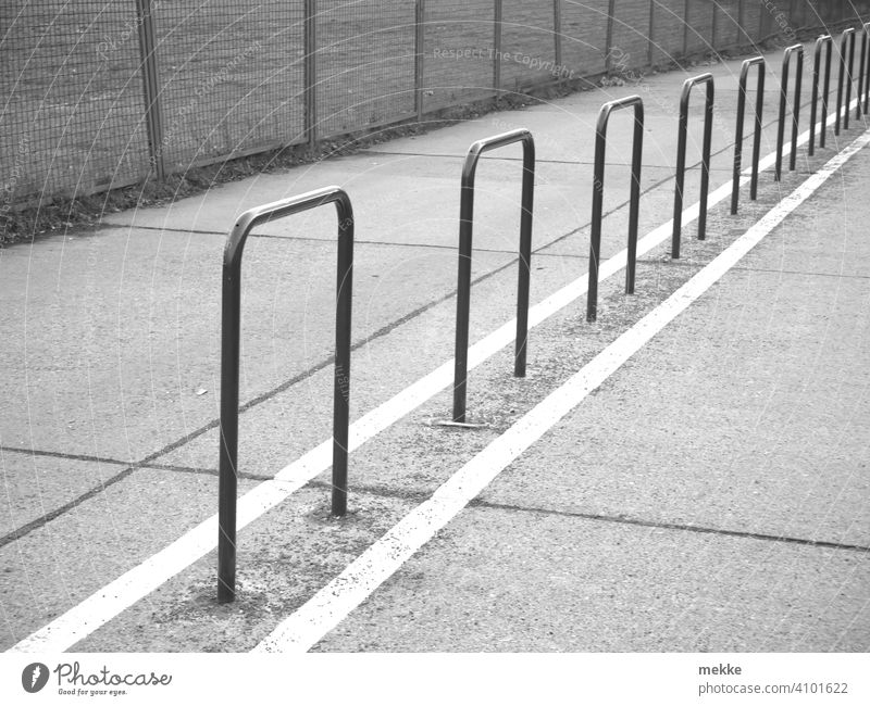 Barriers everywhere Fence off Right ahead Boundary Cycle path Line Structures and shapes Berlin Many Exterior shot Black & white photo Fences Metalware Grating