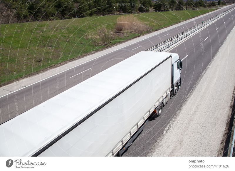 Moving truck with high speed on the countryside highway in a bright day transport road freight vehicle cargo delivery traffic trailer industry trucking fast