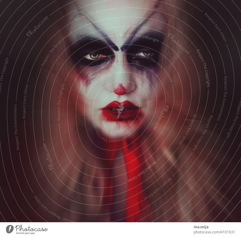 The clown behind the mask Clown Creepy creepy clown Fear Face Hallowe'en Make-up Threat Circus portrait Mask Carnival Looking Eerie spooky Human being Adults