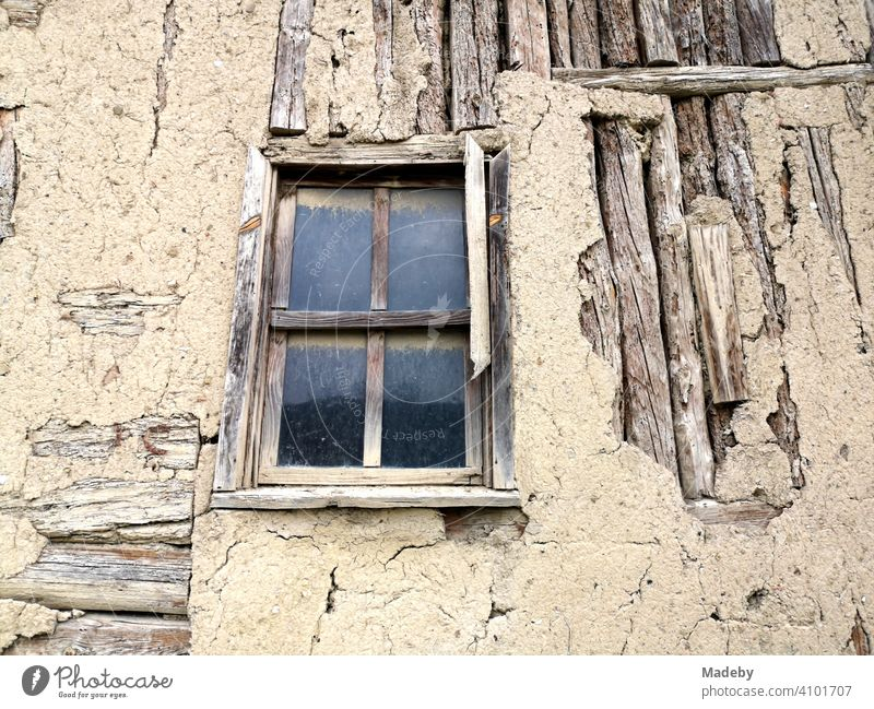 Old wooden house with mullioned windows and crumbling plaster in the old town of Tarakli near Adapazari in the province of Sakarya in Turkey Window