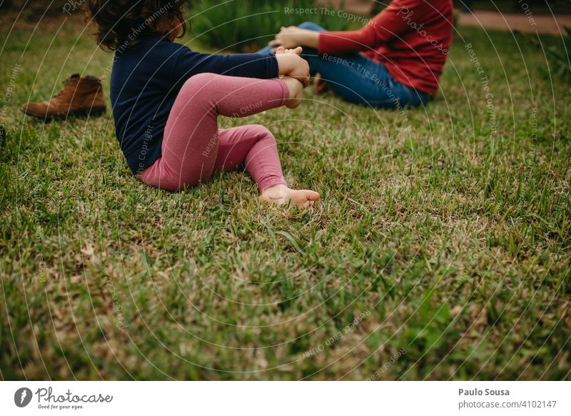 Child barefoot on the grass Girl 1 - 3 years Caucasian Barefoot Grass Spring Feet Cute Meadow Summer Colour photo Human being Infancy 3 - 8 years Exterior shot