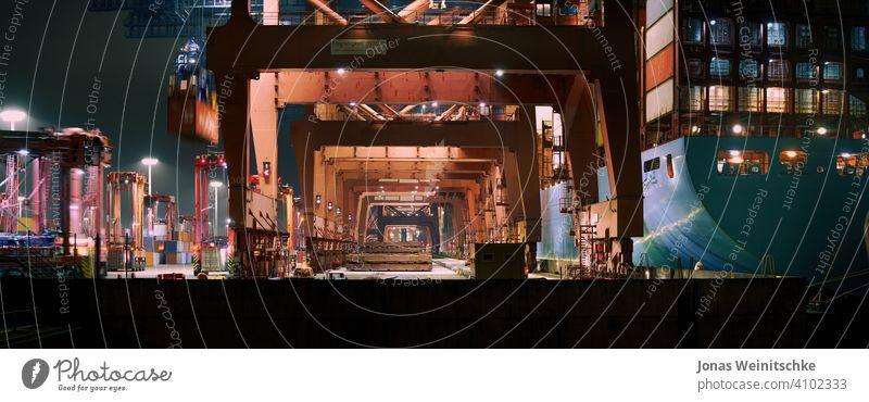 Container terminal in Hamburg in the evening europe export iron bridge crane ship freight port of hamburg containership crane shipping vessel distribution