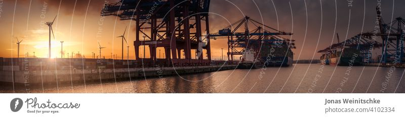 Large sunset panorama of a container terminal in Hamburg shipyard fine unloading editorial burchardkai daylight elbe river transportation system handling export