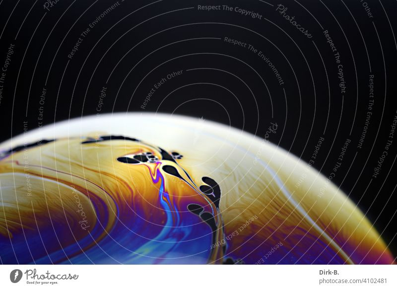 Here you can see a macro shot of a soap bubble. Soap bubble Close-up color Planet black background Bubble colored Design Abstract Style Structures and shapes