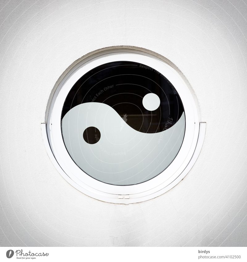 Yin and Yang, asian spiritual sign of the connection of duality as a round window in a house wall Round Spirituality Circular Window Symbols and metaphors