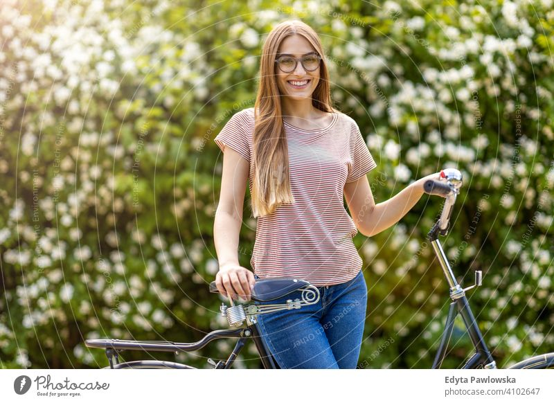 Young woman going for a bicycle ride in the park active Bicycle Bike On The Move commuter transport cycling biking healthy eco-friendly ecological enjoying