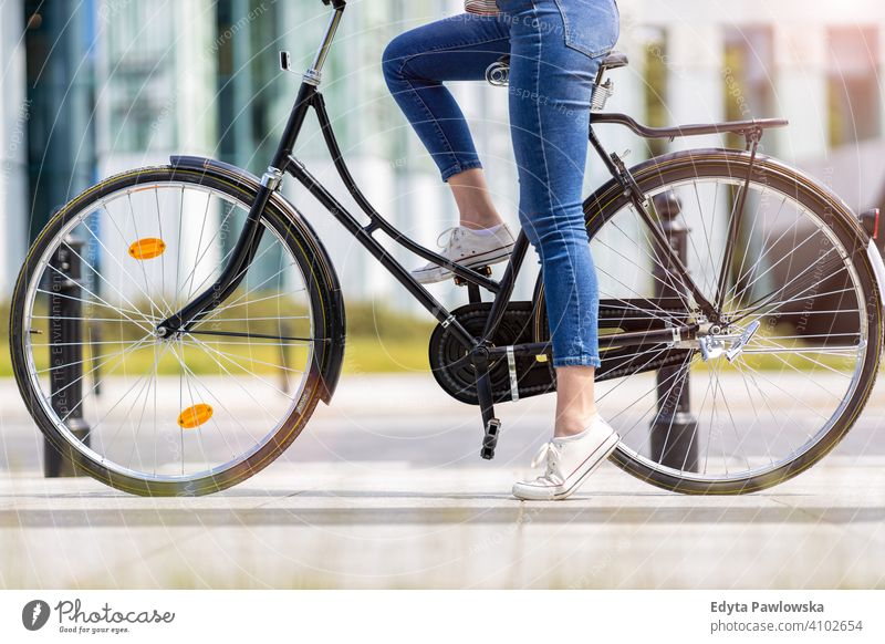 Legs of a young woman on a bicycle active Bicycle Bike On The Move commuter transport cycling biking healthy eco-friendly ecological enjoying lifestyle adult
