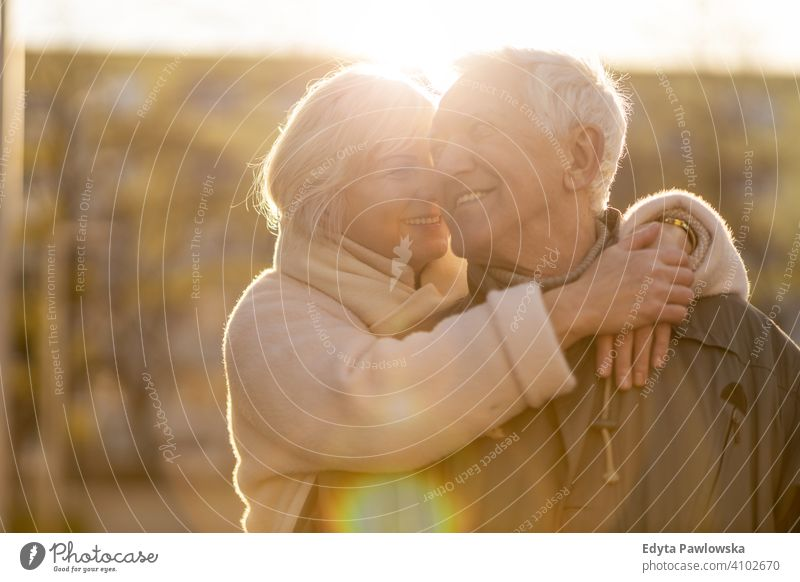 Senior couple hugging outdoors in autumn woman love people together two senior mature pensioners togetherness retiree retired retirement old marriage healthy