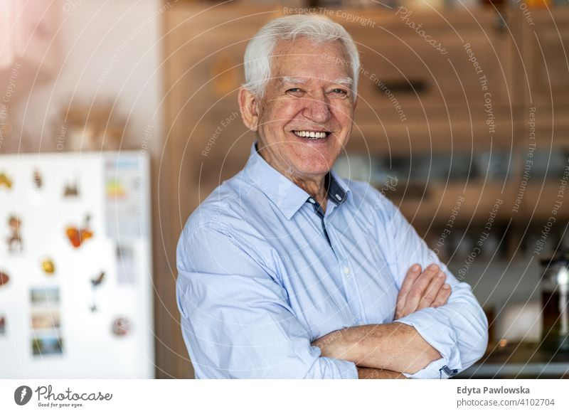 Smiling senior man in his home people one person mature pensioners retiree retired retirement old elderly gray hair caucasian adult lifestyle happy smiling