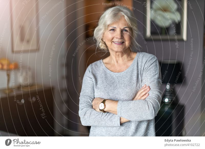 Smiling senior woman in her home people one person mature pensioners retiree retired retirement old elderly gray hair caucasian adult lifestyle beautiful