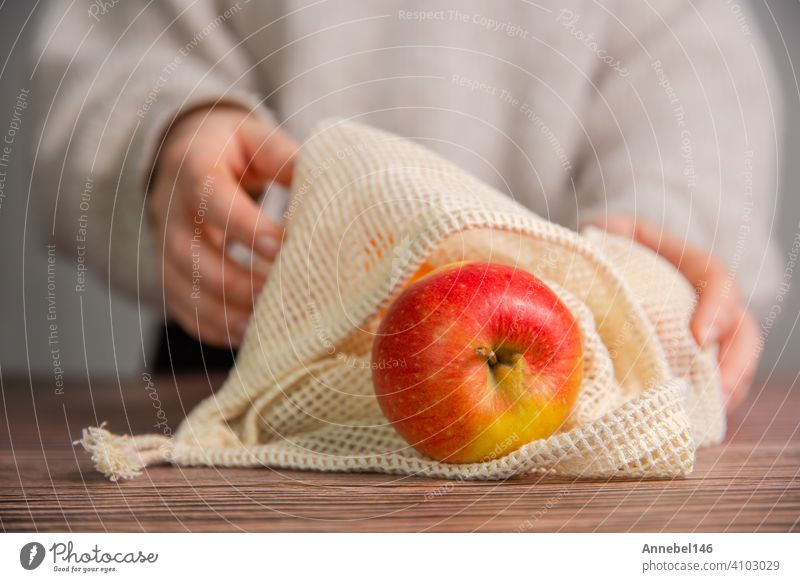 Apples in an eco friendly bag, Eco friendly bag with red fresh apples with copy space, fruit, health, environmental concept reuse Reusable Shopping Ecological