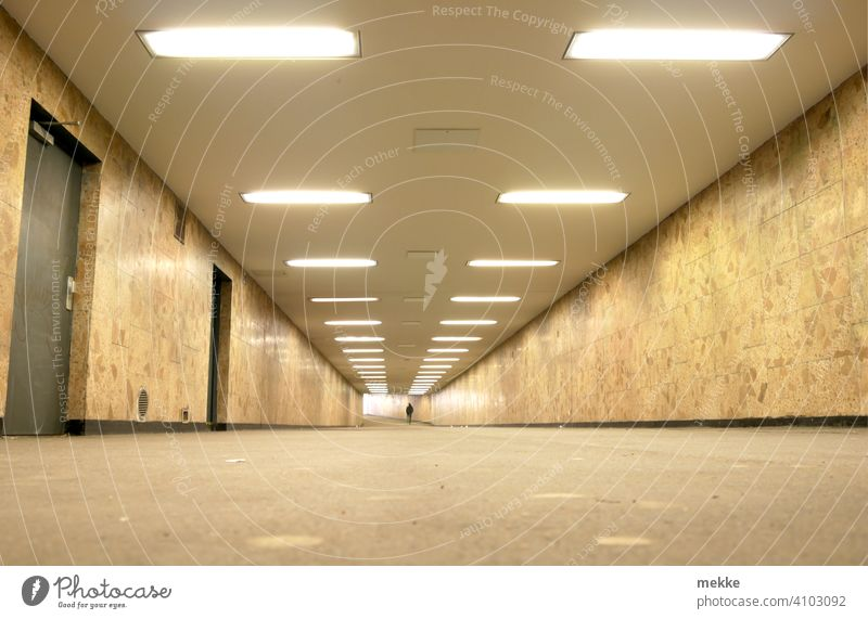 Illuminated clean station tunnel in Berlin Marzahn Underpass Tunnel Train station Town Transport Lanes & trails Tunnel vision Empty Architecture Underground