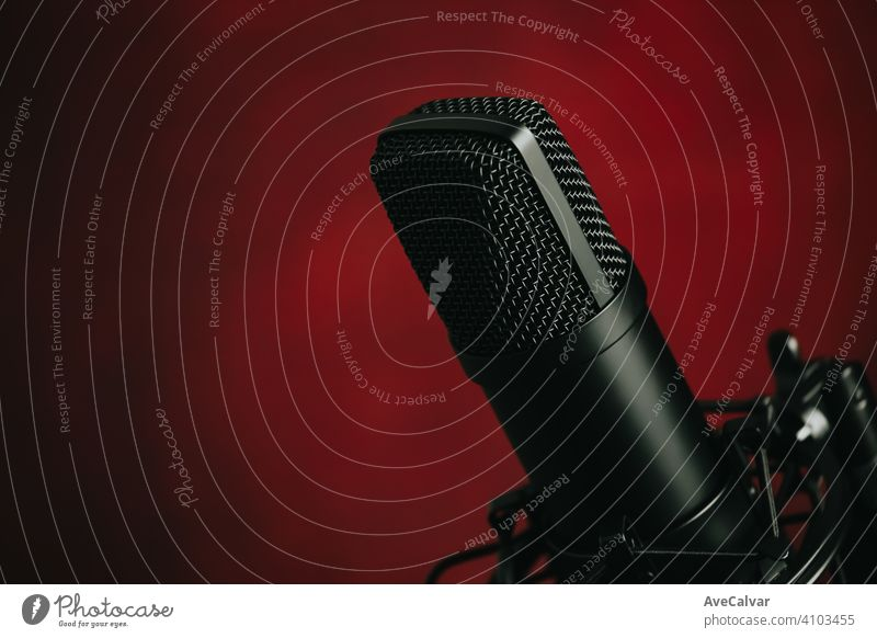 A close up of a streaming microphone over a red background with copy space record audio technology music professional sound radio recording studio apartment