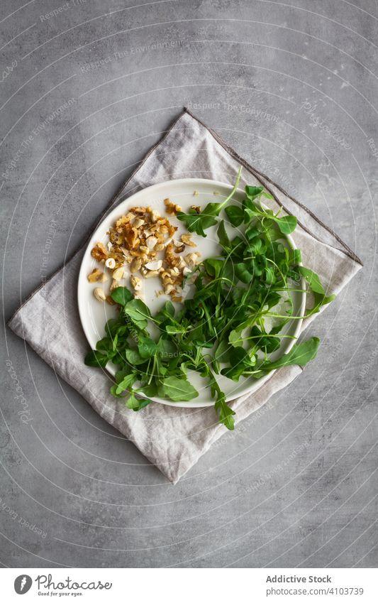 Herbs and nuts on plate herb ingredient cook salad napkin natural kitchen healthy fresh food vegetarian vegan diet organic nutrition cuisine green gourmet