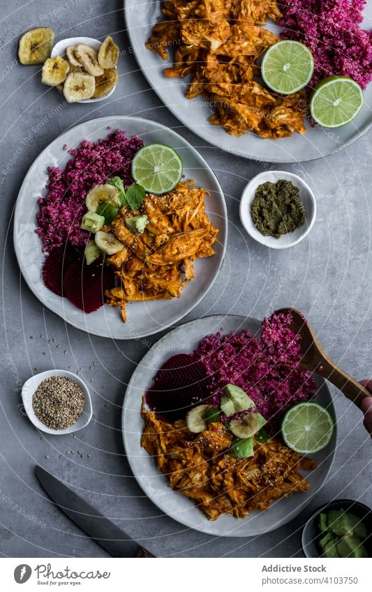 Plates with red quinoa and chicken curry healthy food plate natural meal organic cuisine delicious recipe dish portion dinner diet lunch spicy colorful meat