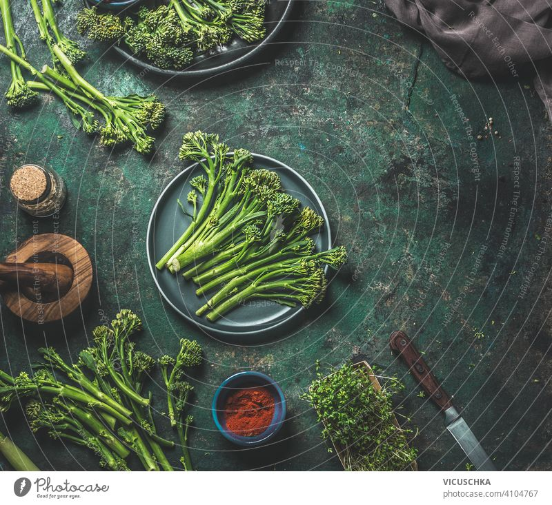 Wild broccoli on dark rustic background . Cooking preparation. Top view. Healthy food wild cooking top view healthy food kitchen table meal woman holding