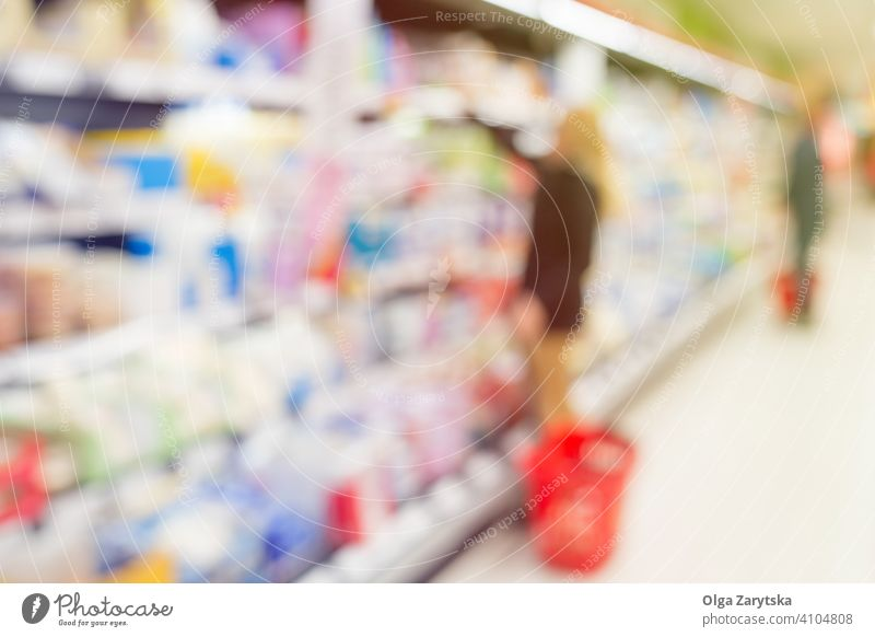 Blurred people in supermarket. food shopping background woman blur product blurred inside interior retail store customer shelf depth distribution merchandise