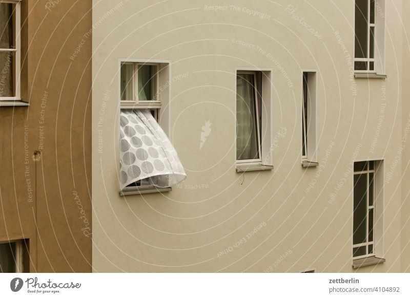 Curtain in the window opposite when there is a draught Old building on the outside Fire wall pull through Facade Window House (Residential Structure)