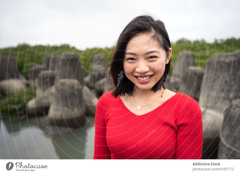 Satisfied Asian woman on vacation during excursion sightseeing tourism happy smile asian ethnic casual travel rock relaxation female summer beautiful taiwan