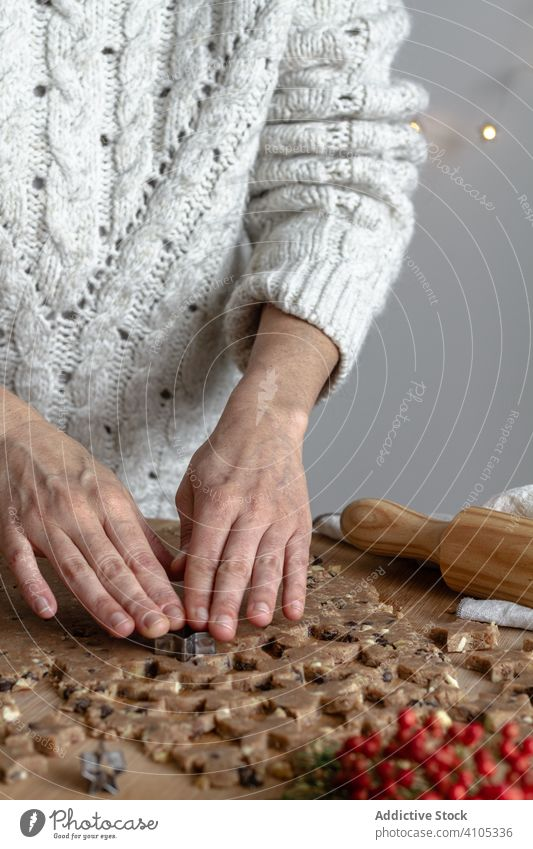 Anonymous lady preparing cookies with tin form for baking cooking using woman kitchen rolling pin dough process shape star festive pastry preparation food arms