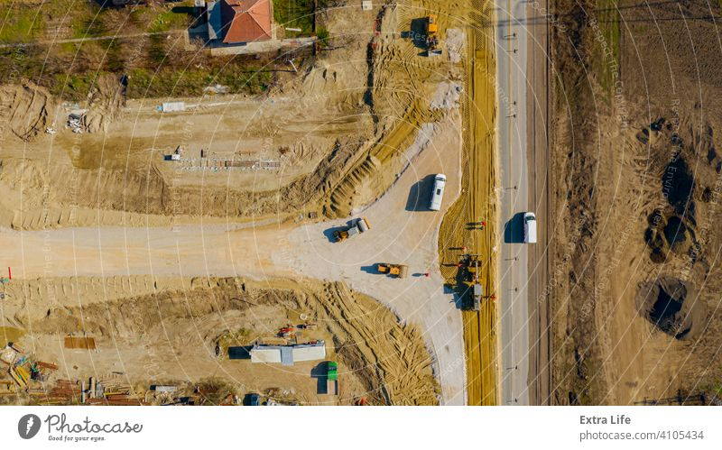Aerial view on grader as leveling sand over construction site for new traffic roundabout Above Align Alignment Base Building Site Circle Circular