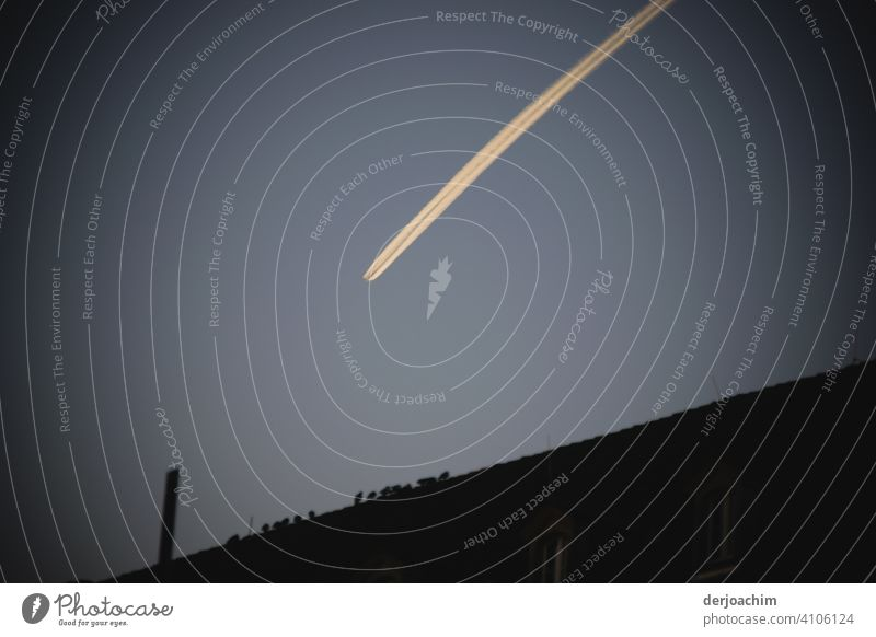 Mysterious movement in the evening sky . Account stripes of the plane at high altitude over the city.... Sky Cloudless sky Beautiful weather Exterior shot