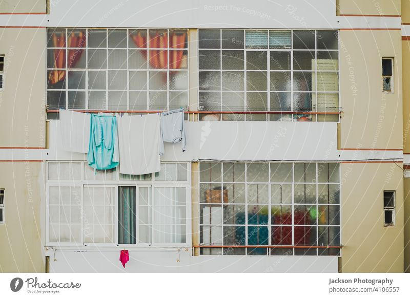 Old and new windows in a bit obsolete condominium in Faro, Portugal apartments flat faro algarve detail pattern laundry portugal social clothes townhouse