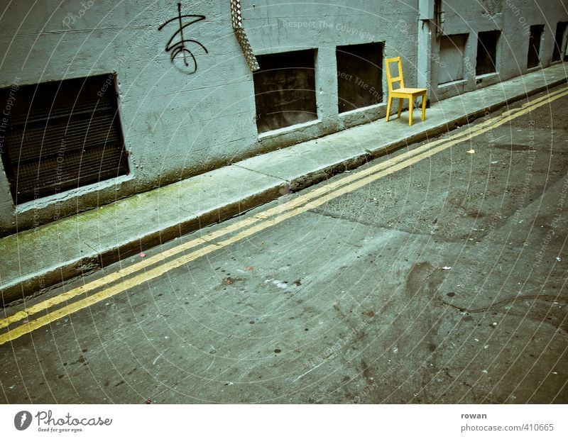 seating Transport Traffic infrastructure Road traffic Motoring Street Dark Gloomy Town Chair Yellow Sit Wait Empty Facade Ghetto Stripe Line Loneliness