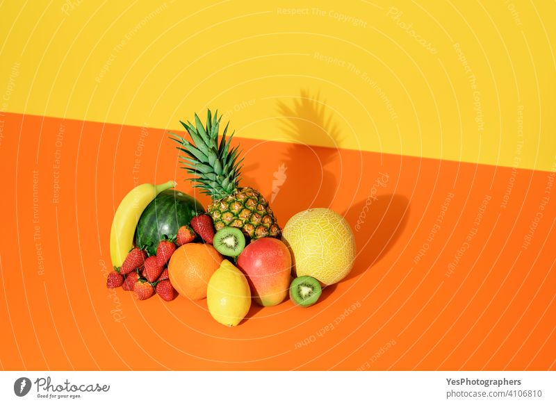 Tropical fruits isolated on a colored background. Fresh summer fruits. ananas assorted banana cantaloupe citrus colorful colors copy space creative cut out