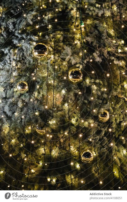 Christmas tree with balls and lights christmas decoration tradition festive shiny season winter december illuminate glow celebrate design golden style texture