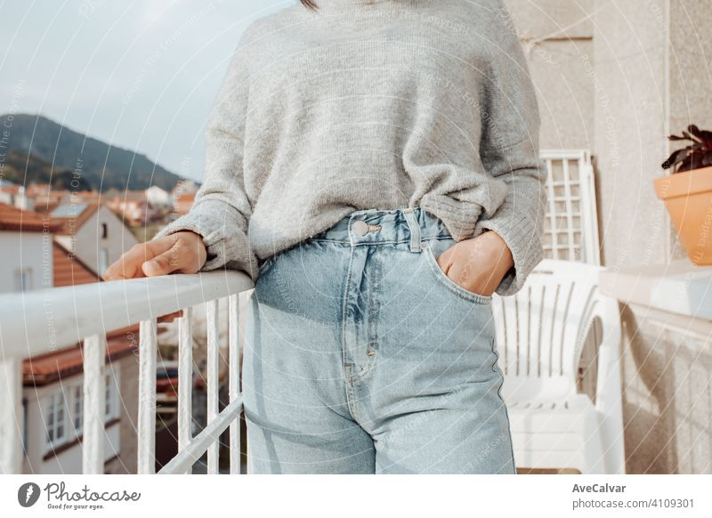 Close up of a woman wearing mom jeans with copy space during a bright day, fashion and styling concept person female elderly retirement senior smile aged happy