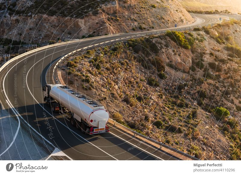 Fuel tanker driving on a mountain road by the sea. Camion cisterna mercancias peligrosas suministro combustible Dangerous Montaña Curvas Adr Inflamable