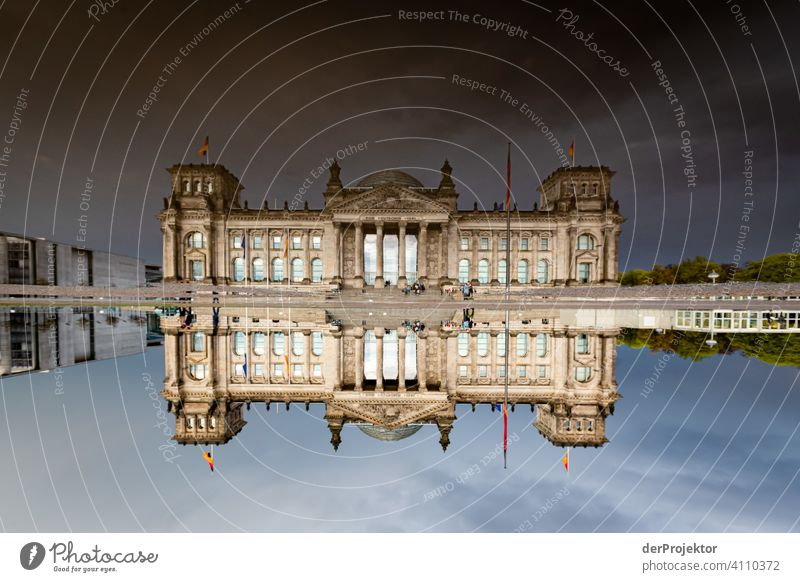 Reichstag in the reflection of a puddle I Central perspective Reflection Shadow Copy Space top Twilight Artificial light Light Copy Space right Copy Space left