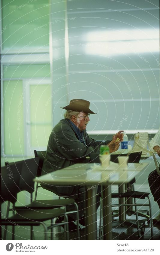 airport cowboy Cowboy Artificial light Loneliness Senior citizen Human being Airport Male senior Hat Nutrition Wait Sadness Care of the elderly