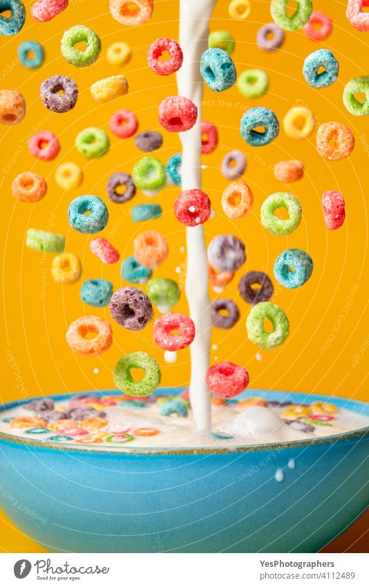 Milk and cereal poured in a bowl. Preparing breakfast, creative layout assorted background blue bright cereal bowl cereals close-up colorful colors cornflakes