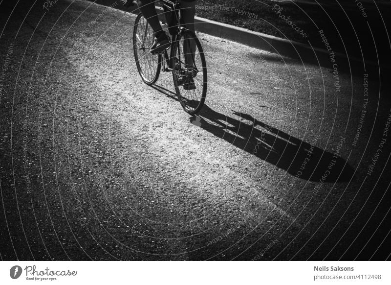 Shadow of man riding bicycle on street. Action activity asphalt balance bicycling bike adult city cute exercise fun joy leisure lifestyle little nature outdoor