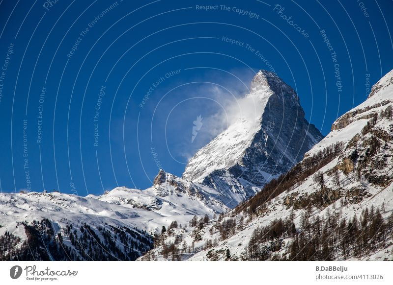 The Matterhorn rises above Zermatt.  At 4478m, it is one of the highest mountains in the Alps and one of the most famous mountains in the world because of its striking shape.