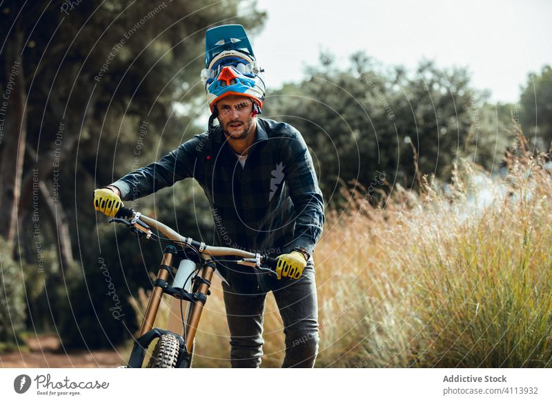 Man walking with mountain biking trail nature mtb rider equipment speed cycle professional lifestyle fit fun sport cyclist adventure track extreme adult bicycle