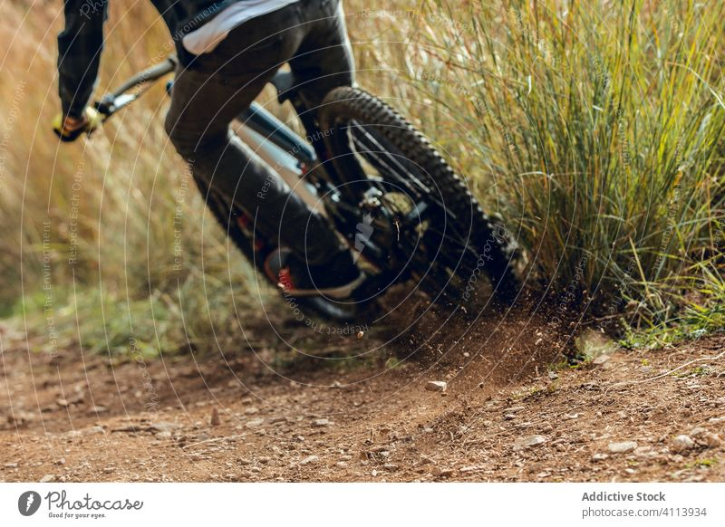 Anonymous man on mountain biking training trail nature mtb rider equipment speed cycle professional lifestyle fit fun sport cyclist adventure track extreme