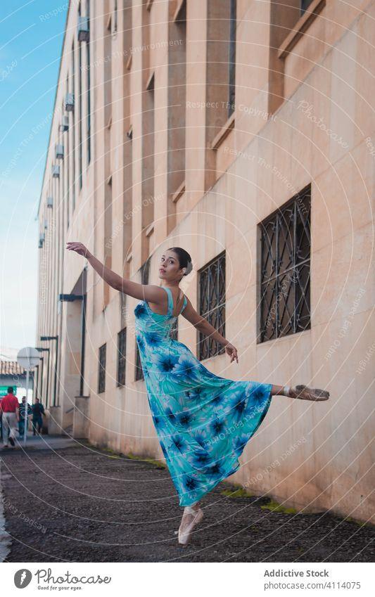 Young woman dancing on street dance ballet grace building concept young slim dress female elegant ballerina shabby city perform dancer exterior move flexible