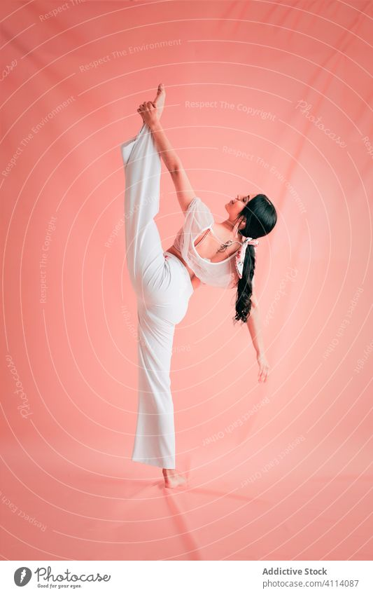 Elegant woman doing splits during dance grace concept young slim ballet elegant outfit female ballerina perform barefoot style trendy dancer move flexible