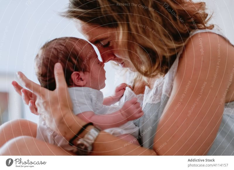 Happy mother holding newborn child happy woman baby care together love motherhood smile kid parent adorable childhood innocent infant little cute comfort