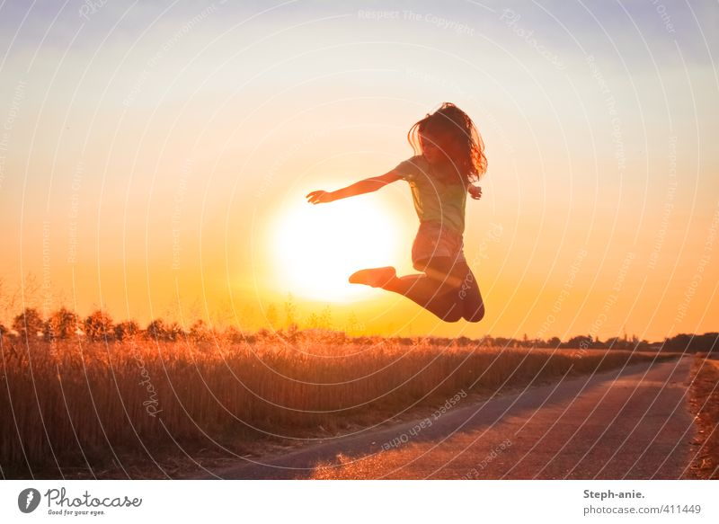 Sunset jumper Feminine Young woman Youth (Young adults) 1 Human being Sky Sunrise Sunlight Summer Beautiful weather Field Movement Jump Illuminate Happiness