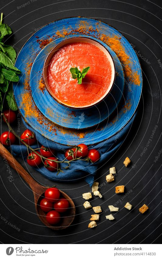 Homemade tomato soup with bread, mint and olive oil healthy food lunch tasty background nutrition vegan food traditional gourmet homemade spoon fresh
