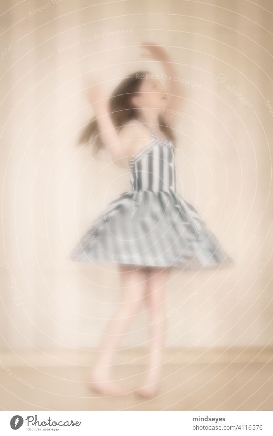 Little striped dancer intentionally blurry Dress Striped Dancer dancing girl Feminine Colour photo Human being Portrait photograph young Beautiful costume