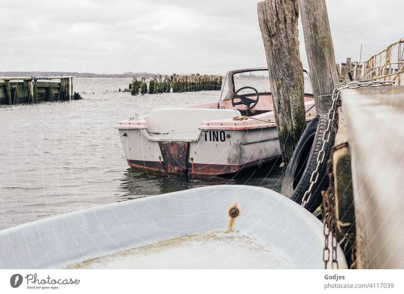 Old weathered boats moored to a wooden jetty Footbridge Navigation Water Ocean Exterior shot Watercraft Colour photo Harbour Summer Sky Deserted