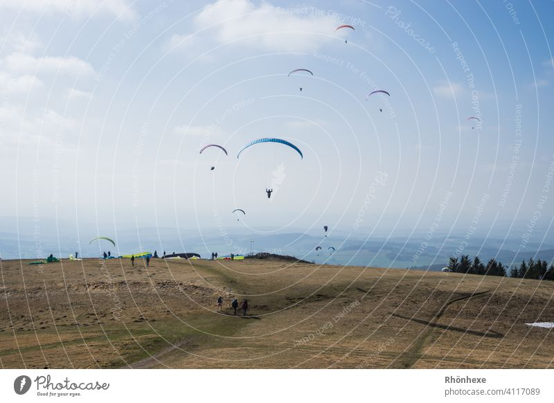Easter Saturday with the paragliders on the Wasserkuppe Paragliding Flying Sky Freedom Paraglider Leisure and hobbies Exterior shot Sports Aviation Air Mountain
