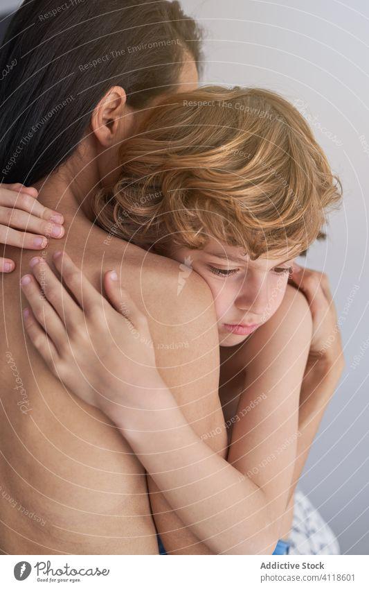 Tender mother embracing sad son kid hug comfort woman boy bare tender together love embrace parent care child affection female relationship childhood cuddle