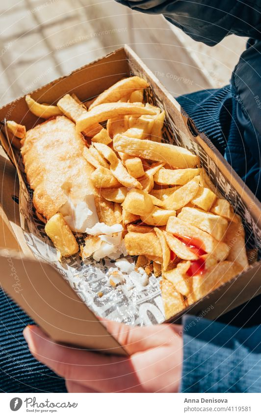 Fish and Chips with peas fish and chips sauce take away food english crispy fillet dinner british fried street food outside covid lockdown local altrincham
