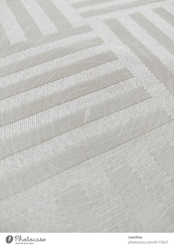 Satin and elegant creamy tablecloth textile clean white luxury wealth texture textured satin satiny lines composition pattern gradient silver pearl ivory color